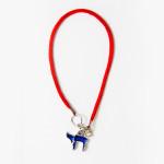 Blue Chai pendant on red string bracelet