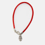 A Red String Kabbalah Bracelet with a Silver Hamsa