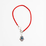 Evil Eye Hamsa pendant on a red string bracelet
