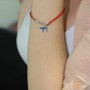 Evil Eye Teal Chai pendant on a red string bracelet